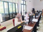 aktivitas-di-posko-monitoring-bkpp-kabupaten-batola-kalsel-selasa-03082021.jpg