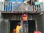 anggota-baznas-tanggap-bencana-btb-kalimantan-selatan-warga-terdampak-banjir.jpg