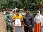 anggota-kodim-1002barabai-polres-hst-serahkan-bantuan-presiden-ri-ke-korban-banjir.jpg
