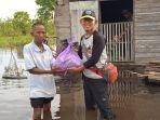 asosiasi-juri-drumband-menyalurkan-bantuan-untuk-warga-terdampak-banjir.jpg