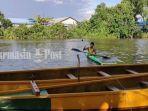 atlet-dayung-berlatih-di-sungai-awang-banjarmasin-provinsi-kalsel-senin-11012021.jpg