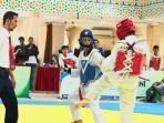 atlet-taekwondo-banjarbaru-angga-anantama-subagja-biru-saat-mengikuti-event-uin-antasari-cup.jpg