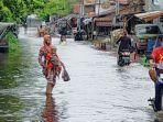 banjir-akibat-meluapnya-sungai-kahayan-sudah-masuk-ke-halaman-pasar-kahayan.jpg