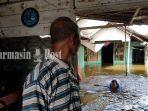 banjir-desa-gunungraja-tambangulang-kabupaten-tala-provinsi-kalsel-selasa-12012020.jpg