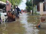 banjir-di-desa-pekauman-kecamatan-martapura-timur.jpg
