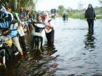 banjir-di-desa-trans-lajar-papuyuan-lampihong-balangan_20180109_163941.jpg