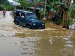 banjir-di-jalan-kabupaten-desa-muang-rt-3-kecamatan-jaro.jpg