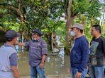 banjir-di-kalsel-kepala-dinas-pupr-kabupaten-tanbu-subhansyah-memeriksa-wilayah-terdampak-banjir.jpg