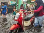 banjir-di-kawasan-jalan-kelayan-a-ii-kelurahan-murung-raya-banjarmasin-sabtu-16012021.jpg