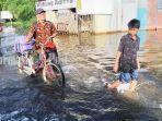 banjir-parah-di-desa-puntik-tengah-kecamatan-mandastana-batola-kalsel-januari-2021.jpg