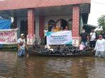 bank-syariah-mandiri-banjarmasin-antarkan-bantuan-untuk-warga-terdampak-banjir-23012021.jpg
