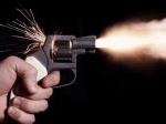 bunuh-diri-pistol.jpg
