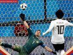 capture-mohamed-salah-mencetak-gol-penalti_20180620_040744.jpg