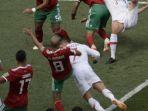 cristiano-ronaldo-menyundul-bola-ke-arah-gawang-maroko_20180621_082049.jpg