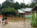 desa-ambakiang-dan-tundakan-teredam-banjir-senin-112018_20180101_151114.jpg
