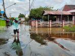 desa-tunggul-irang-ulu-kota-martapura-kabupaten-banjar-terendam-selasa-06042021.jpg