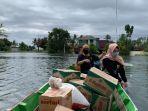 dispersip-kalsel-bahan-pangan-korban-banjir-kecamatan-bumi-makmur-kabupaten-tala-17012021.jpg