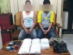 dua-dari-empat-tersangka-beserta-barang-bukti-narkoba-asal-malaysia-yang-diamankan-petugas-gabungan.jpg