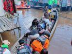 evakuasi-seorang-korban-tenggelam-di-sungai-kapuas-kalteng-selasa-18052021.jpg