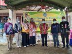 foto-bersama-usai-pembukaan-pelaksanaan-pasar-murah-di-kelurahan-raya-belanti-kecamatan-binuang.jpg