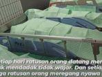foto-viral-jenazah-berjejer-ditutup-kain-di-selasar-rumah-sakit-menjadi-viral-di-media-sosial.jpg