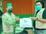 founder-yayasan-selfii-salurkan-makanan-dan-vitamin-untuk-warga-isoman-31072021.jpg