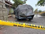 garis-polisi-melintang-di-lokasi-penemuan-mayat-wanita-tewas-di-mobil-terbakar.jpg