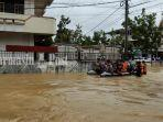 ilsutrasi-jalan-terendam-akibat-banjir-di-kabupaten-hst-provinsi-kalsel-17012021.jpg