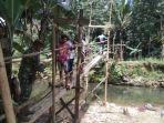 jembatan-darurat-desa-murung-b-desa-patikalain-hantakan-kabupaten-hst-18012021.jpg