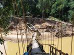 jembatan-gantung-di-desa-haliau-htt-putus-diterjang-banjir-bandang.jpg