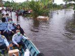 kanwil-kemenkumham-kalsel-menyalurkan-bahan-pangan-untuk-korban-banjir-rabu-20012021.jpg