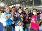 karateka-banjarmasin-m-rafli-yunanda-tengah-mendapatkan-medali-emas-popda-14072021.jpg