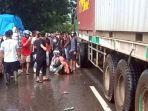 kecelakaan-lalu-lintas-antara-motor-dan-truk-kontainer-di-martapura-kabupaten-banjar-23122020.jpg