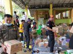 kegiatan-pengemasan-paket-bantuan-oleh-relawan-balakar-654-murakata-12.jpg