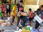kegiatan-pengemasan-paket-bantuan-oleh-relawan-balakar-654-murakata.jpg