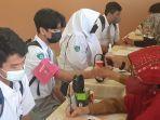 kegiatan-vaksinasi-siswa-di-sma-negeri-1-banjarmasin.jpg