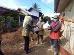 kejari-hsu-bagikan-paket-bantuan-sosial-kepada-warga-selasa-13072021.jpg
