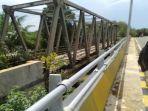 kerangka-jembatan-suka-damai-yang-diharapkan-dipindahkan-ke-batu-harang-mantewe.jpg