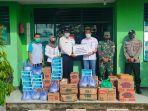 khuzaimi-serahkan-bantuan-untuk-warga-terdampak-banjir.jpg