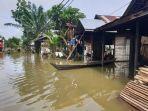 kondisi-banjir-di-desa-jirak-kecamatan-pugaan-tabalong.jpg