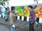 lukisan-di-pagar-kuburan-muslimin-desa-pagaruyung-pagatan-kabupaten-tanbu-sabtu-25092021.jpg