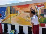 lukisan-mural-di-tembok-jalan-nasional-di-pagatan-tanbu.jpg