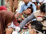 m-ervin-relawan-asal-banjarmasin-saat-menjadi-relawan-di-bencana-gempa-lombok.jpg