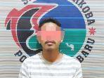 narkoba-kalsel-tersangka-kasus-sabu-muj-ditahan-polres-kotabaru-kalsel-kamis-22072021.jpg