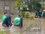 nggota-mapala-sylva-fakultas-kehutanan-ulm-evakuasi-korban-banjir.jpg