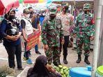 operasi-yustisi-di-pasar-mabuun-kabupaten-tabalong-kalsel-sabtu-12062021.jpg