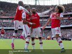 para-pemain-arsenal-merayakan-gol-yang-dicetak-oleh-pierre-emerick-aubameyang.jpg