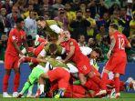 para-pemain-inggris-merayakan-kemenangan-timnya-atas-kolombia_20180707_073234.jpg