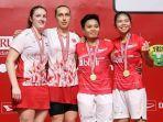 pasangan-ganda-putri-indonesia-greysia-poliiapriyani-rahayu-berpose-di-podium.jpg