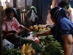 pedagang-sayuran-jumri-48-di-pasar-pekauman.jpg